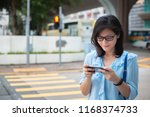 young girl using smartphone on... | Shutterstock . vector #1168374733