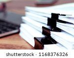stack of documents placed on a... | Shutterstock . vector #1168376326