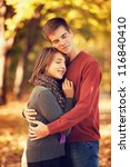 beautiful couple at autumn park. | Shutterstock . vector #116840410