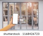 women show blank screen phone... | Shutterstock . vector #1168426723