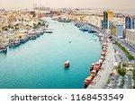 aerial daytime skyline of dubai ... | Shutterstock . vector #1168453549