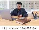 businessman working on mobile... | Shutterstock . vector #1168454416