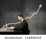 businessman on a background of growth chart - stock photo
