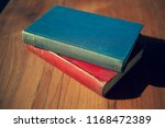 old books on a wooden table | Shutterstock . vector #1168472389