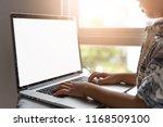 little asian boy using laptop... | Shutterstock . vector #1168509100