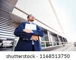 indian man with laptop near the ... | Shutterstock . vector #1168513750