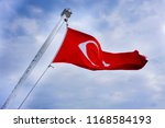 turkis flag waving in blue sky. ... | Shutterstock . vector #1168584193