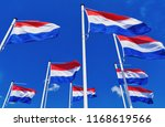 many dutch flags against a blue ... | Shutterstock . vector #1168619566