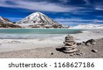 a rock pile stands in front of... | Shutterstock . vector #1168627186