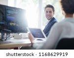 young businesswoman using a... | Shutterstock . vector #1168629919