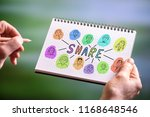 hand drawing share concept on a ... | Shutterstock . vector #1168648546