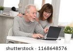 happy mature couple having an... | Shutterstock . vector #1168648576