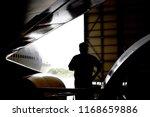aircraft mechanic standing... | Shutterstock . vector #1168659886