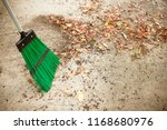 Sweeping dry leaves with broom...