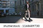 young businessman walking... | Shutterstock . vector #1168689730