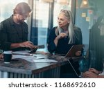 business team working together... | Shutterstock . vector #1168692610