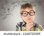 portrait of a cute young boy... | Shutterstock . vector #1168720309