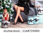 beautiful woman with long slim... | Shutterstock . vector #1168724083