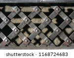 forged grating. forged fence.... | Shutterstock . vector #1168724683