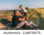 happy young parents sitting and ... | Shutterstock . vector #1168738270