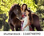 Mother And Daughter With Their...