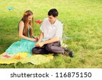 young couple makes out of paper cranes - stock photo