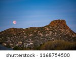 Blood Moon And Thumb Butte In...