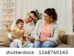 family  parenthood and people... | Shutterstock . vector #1168760143