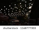 street in the evening near a... | Shutterstock . vector #1168777303