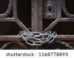 rusty vintage gate at a dark... | Shutterstock . vector #1168778893
