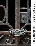 rusty vintage gate at a dark... | Shutterstock . vector #1168778896