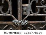 rusty vintage gate at a dark... | Shutterstock . vector #1168778899