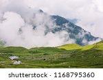 high altitude mountain shelter... | Shutterstock . vector #1168795360