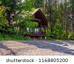 a cabin that is nestled neatly... | Shutterstock . vector #1168805200