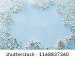frame of white flowers ... | Shutterstock . vector #1168837360