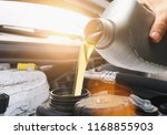 motor oil pouring to car engine | Shutterstock . vector #1168855903