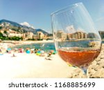 glass of rose wine on the... | Shutterstock . vector #1168885699