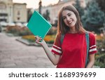 girl student in a red t shirt... | Shutterstock . vector #1168939699