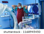 radiology assistant preparing... | Shutterstock . vector #1168945450