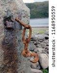 rusty hook hanging on a stone... | Shutterstock . vector #1168950559