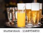 beers and juices | Shutterstock . vector #1168956853