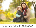mother and daughter walking in... | Shutterstock . vector #1168966666