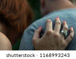 young woman holds a hand on the ... | Shutterstock . vector #1168993243