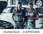 two handsome happy auto... | Shutterstock . vector #1169002600