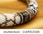 close up of bead rope  seed... | Shutterstock . vector #1169013100