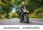 motorbike on the forest road... | Shutterstock . vector #1169016553