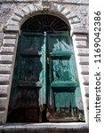 old wooden door worn by age  | Shutterstock . vector #1169042386