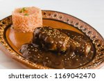 mole poblano with chicken and... | Shutterstock . vector #1169042470