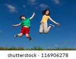 girl and boy jumping  running... | Shutterstock . vector #116906278