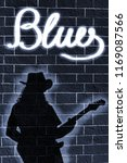 shadow of musician whit guitar... | Shutterstock . vector #1169087566